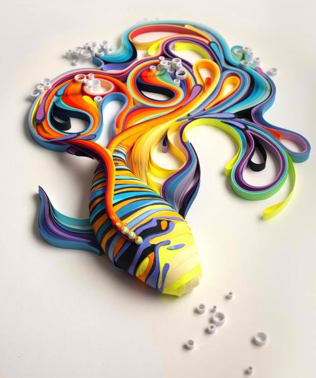 swirling colorful drawings are created with an old paper rolling